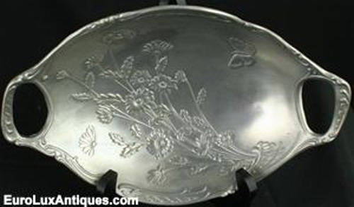 Spring is in the air: vintage French pewter bowl with flowers and butterfly