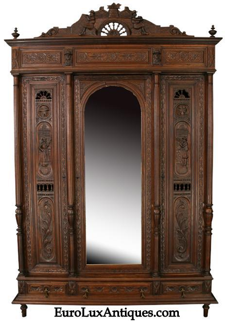 Antique 1880 French Brittany Armoire with fabulous carvings. EuroLuxAntiques.com