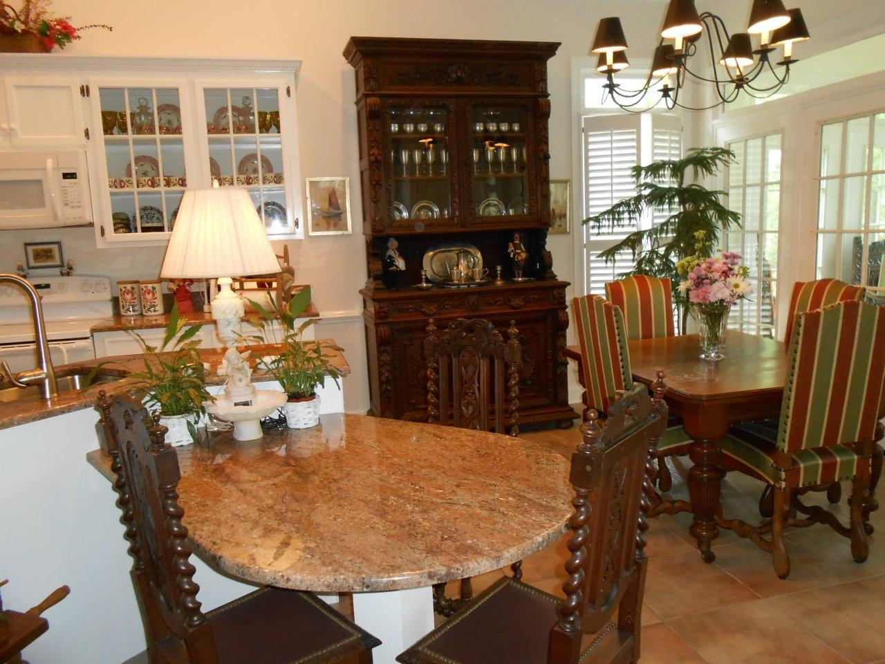 Antique French Hunting Chairs in our client's great room with a Hunting Buffet. EuroLuxAntiques.com