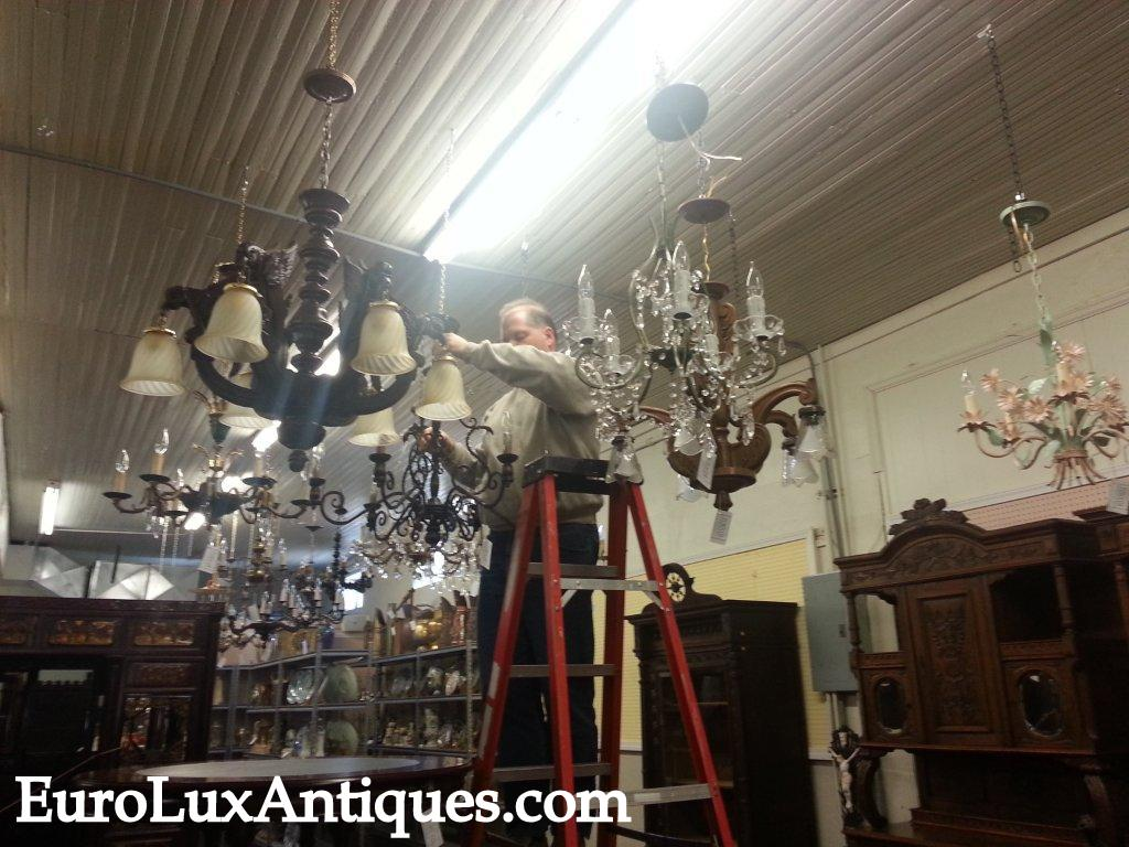 Greg hanging our latest vintage chandelier lighting from France. EuroLuxAntiques.com