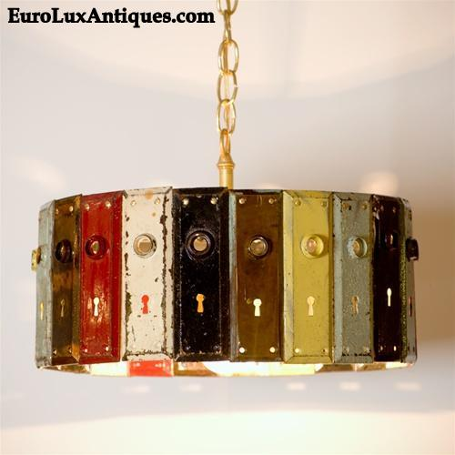 Upcycled chandelier with vintage door plates