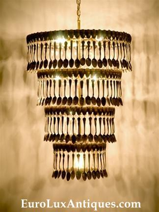 A Spoondelier!High style upcycled chandelier crafted with 360 vintage silverplate spoons. EuroLuxAntiques.com