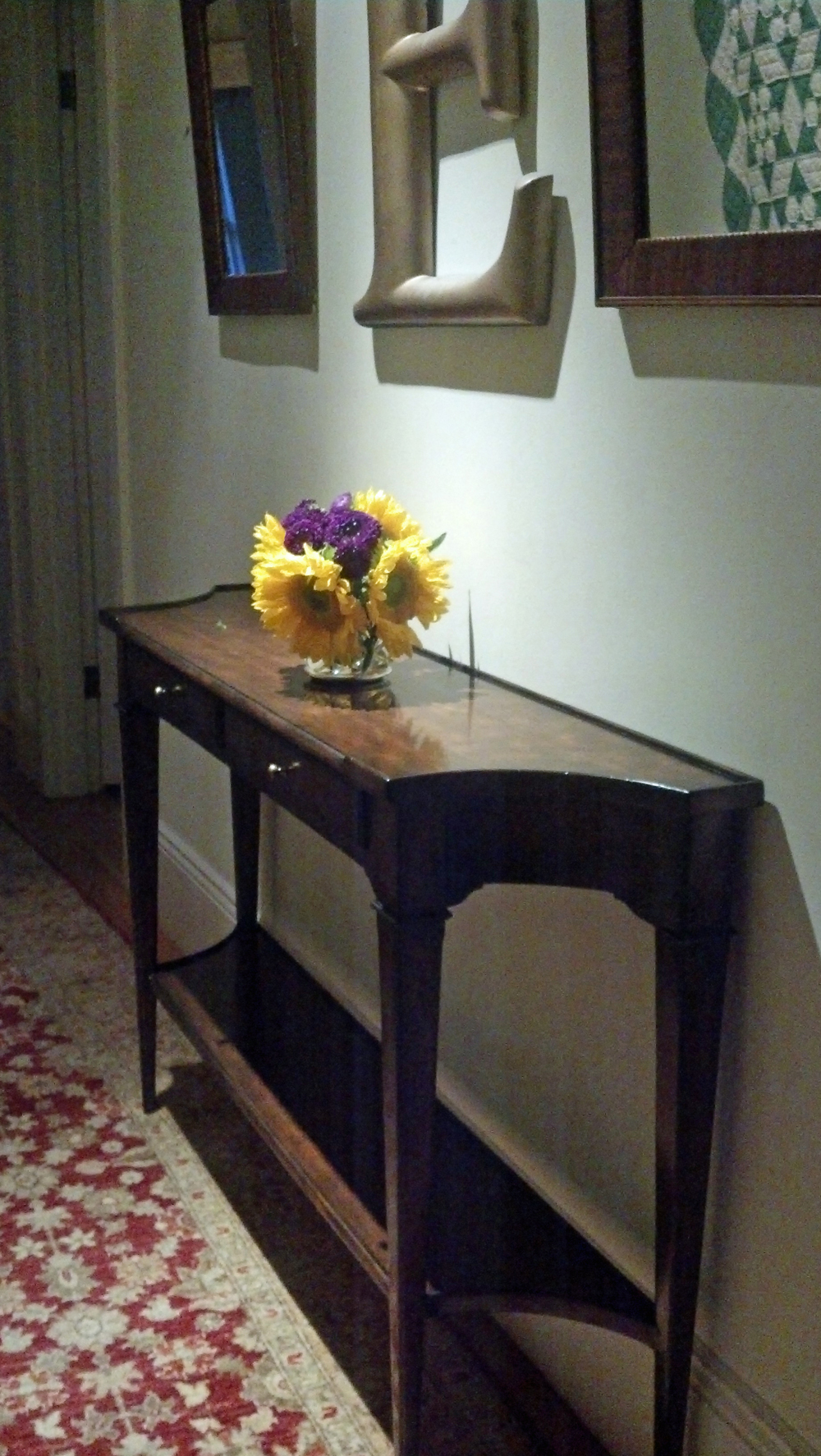Antique inspirations in this reproduction Console Table from EuroLuxAntiques.com, in our client's hallway