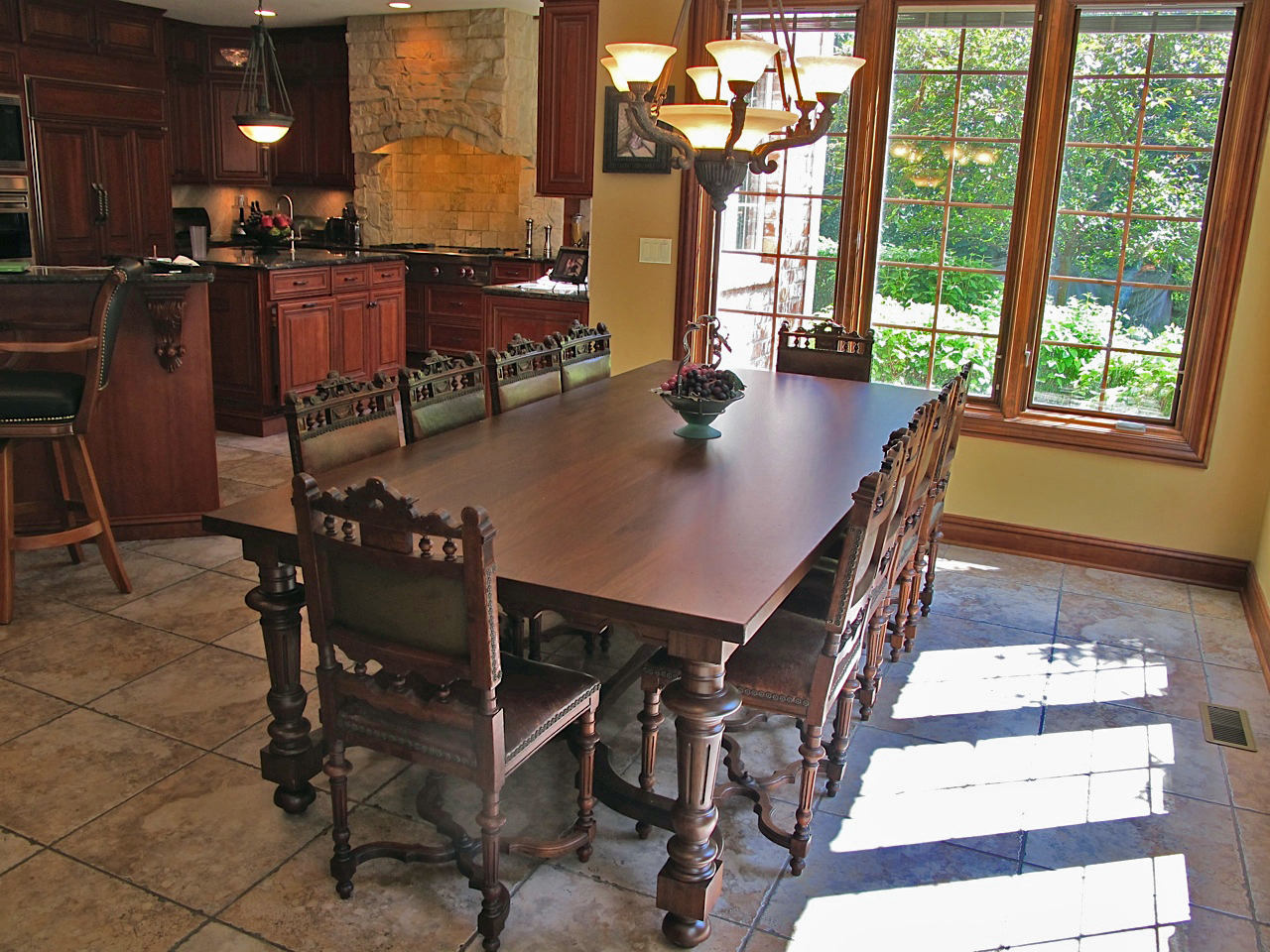 Antique inspirations in our client's French Renaissance kitchen.  Chairs from EuroLuxAntiques.com
