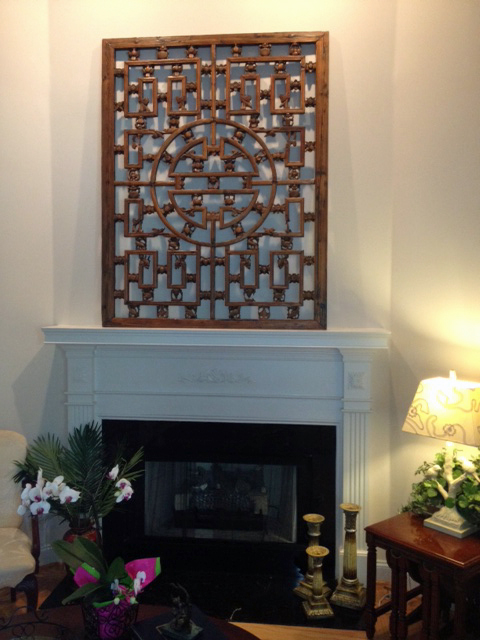 Antique chinese screen over the mantel