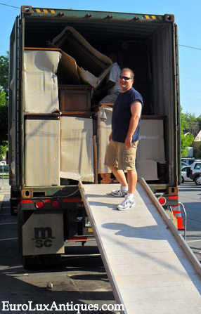 Greg unpacking antique furniture from Europe