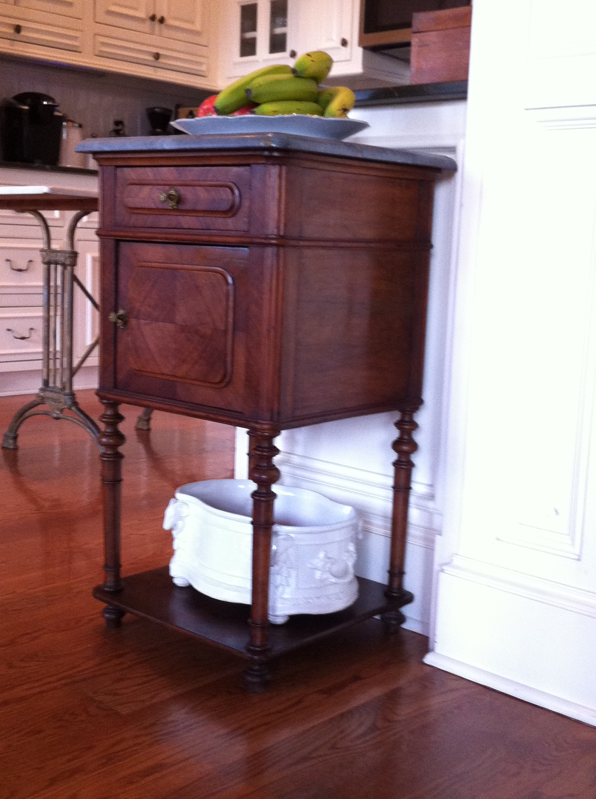 Creative antique decor: antique French nightstand in the kitchen