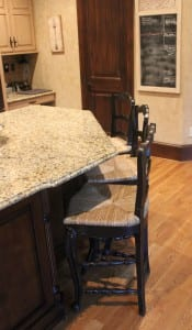 French country stools at kitchen island