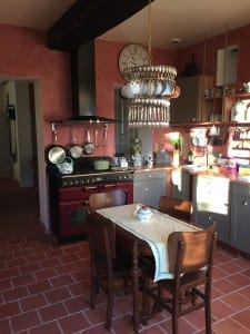 Vintage teaspoon chandelier in kitchen
