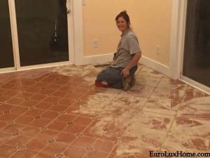 Grouting the floor tile
