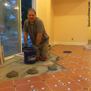 Greg applying mastic for tiles
