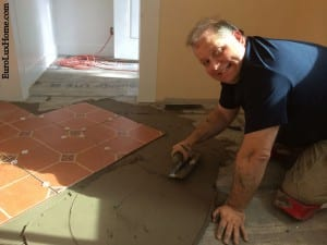 Greg laying tiles