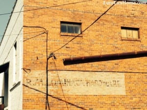 Old sign on EuroLuxHome building