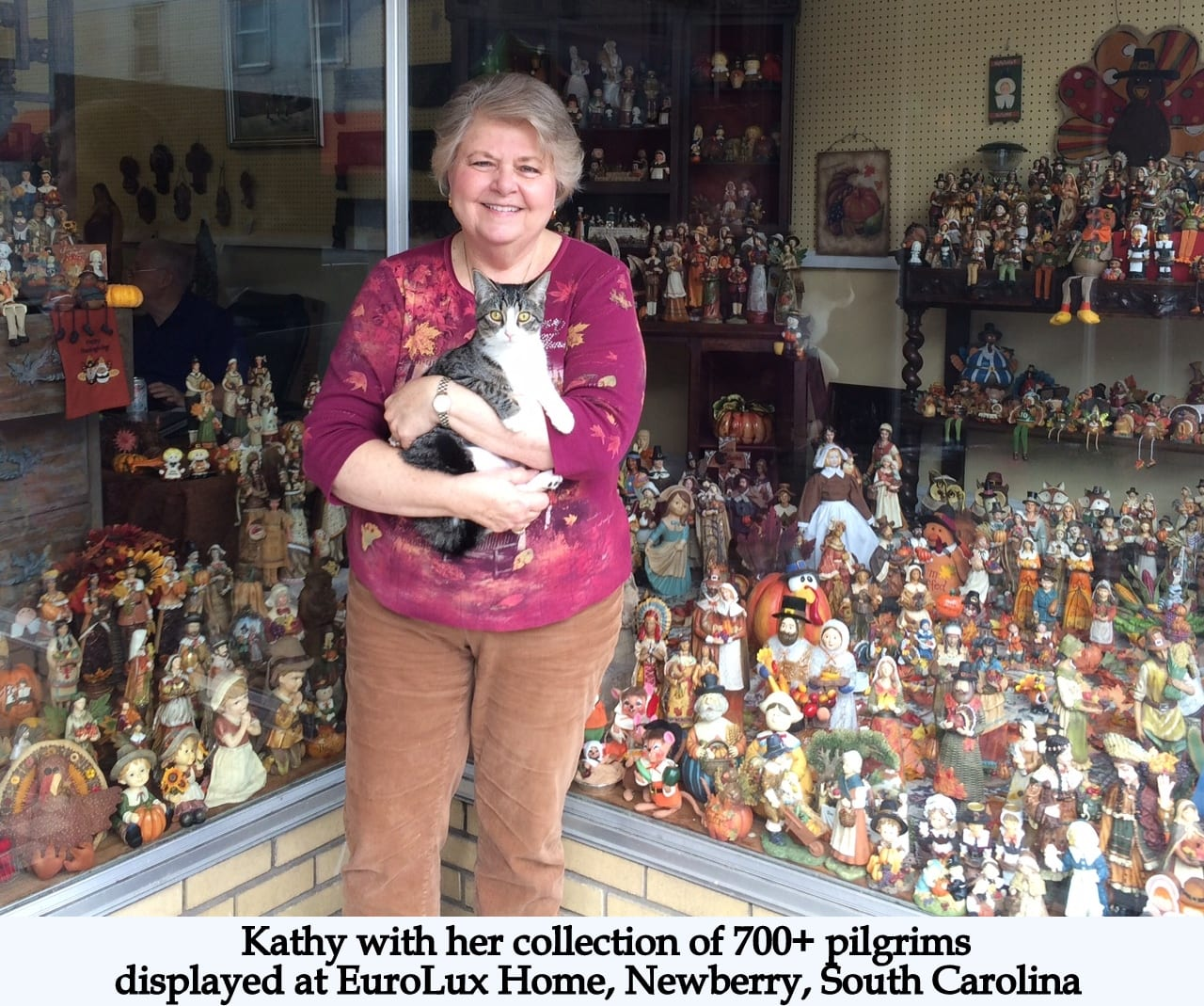 Kathy with her collection of Thanksgiving pilgrims