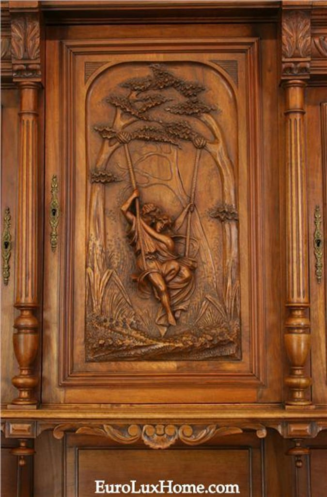 Lovers on a swing carving