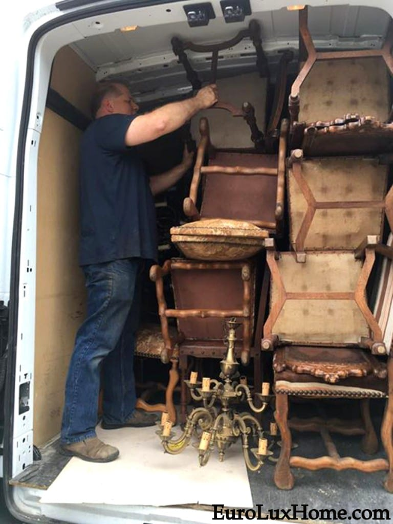 Greg packing antique chandeliers