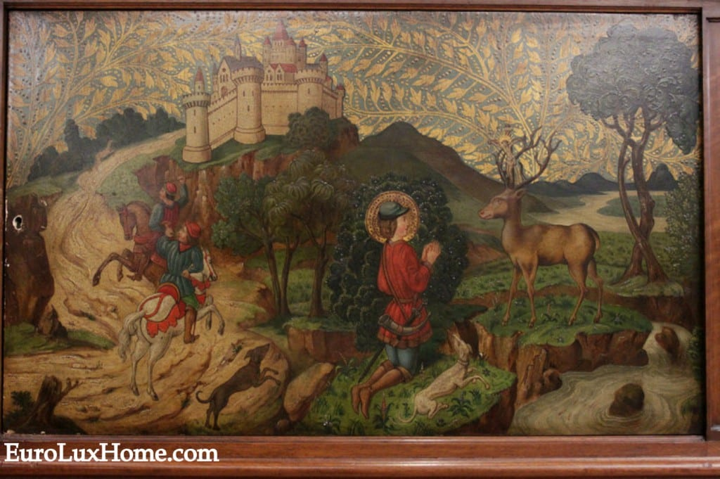 St Eustace painting on antique buffet