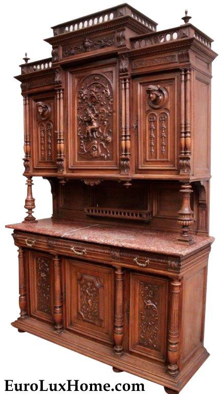 Heavily Carved antique French cabinet