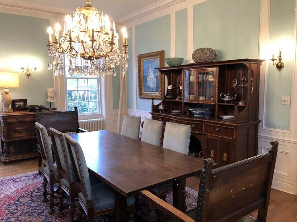 Antique French Louis XIII chairs in dining room