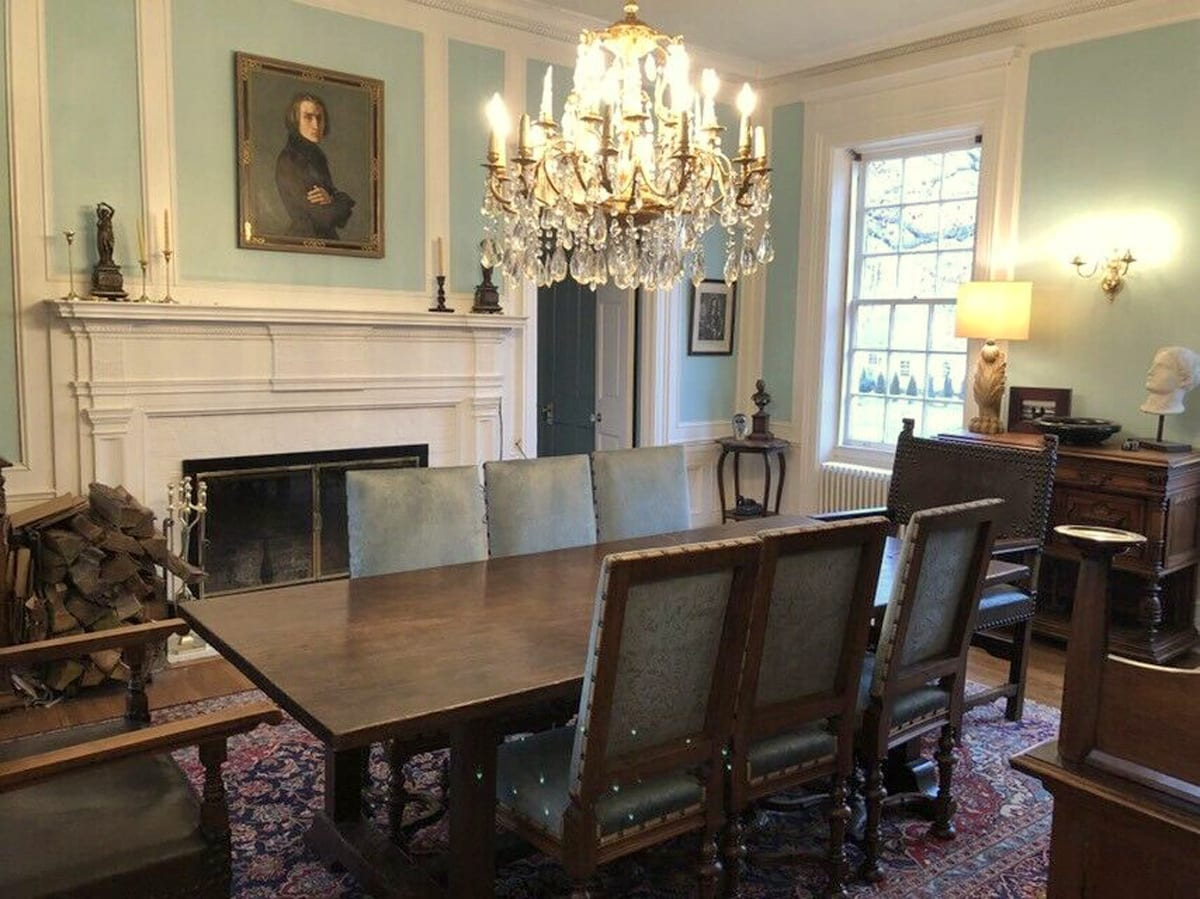 Traditional dining room with antique Louis XIII chairs