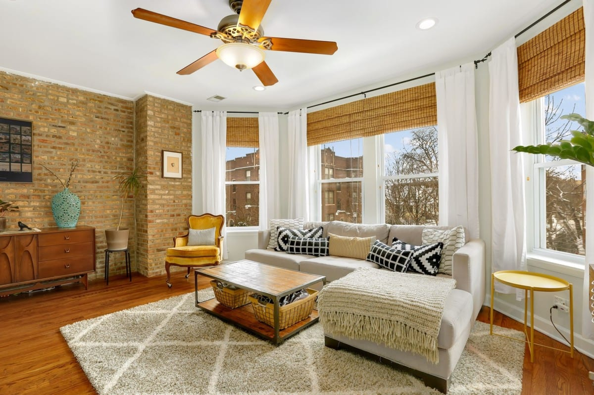 Living room with brick walls and antique furniture pieces